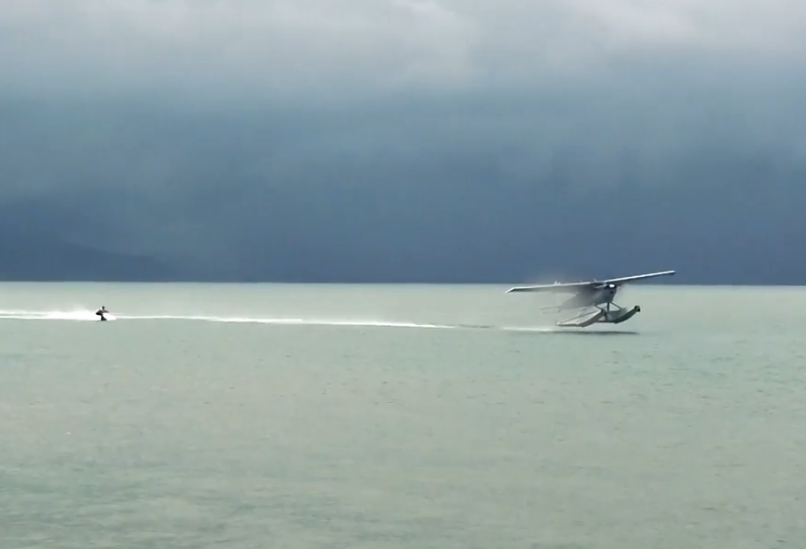 wakeboarding behind a plane
